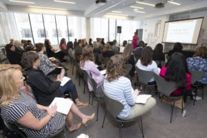 Woman presenting during a breakout group at Engage For Good conference
